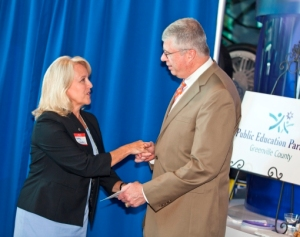 Kathy Weeks, Allen Tate RVP Upstate, presents a check to Greenville County Schools Superintendent W. Burke Royster
